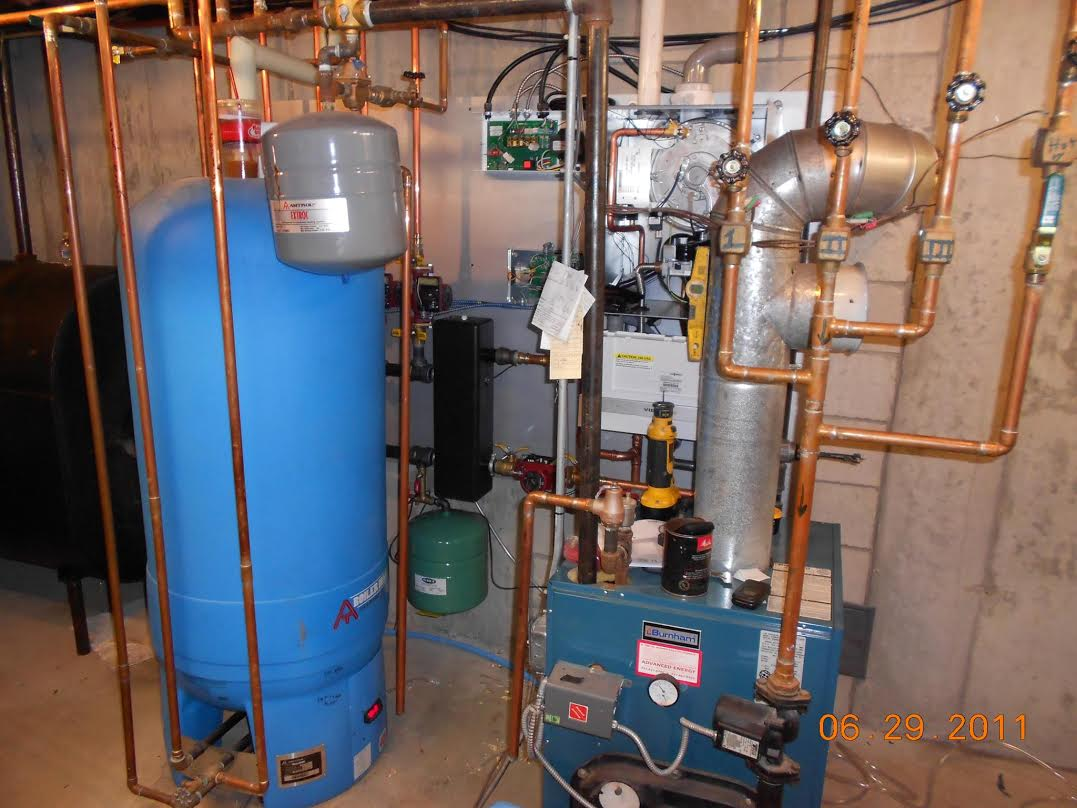 Oil-Gas Conversion – Tight mid-winter conversion. New boiler wall ...